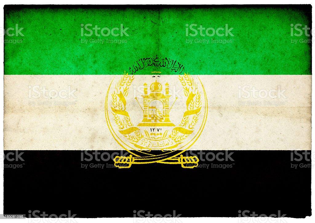 Grunge Afghan Flag on rough edged old postcard stock photo