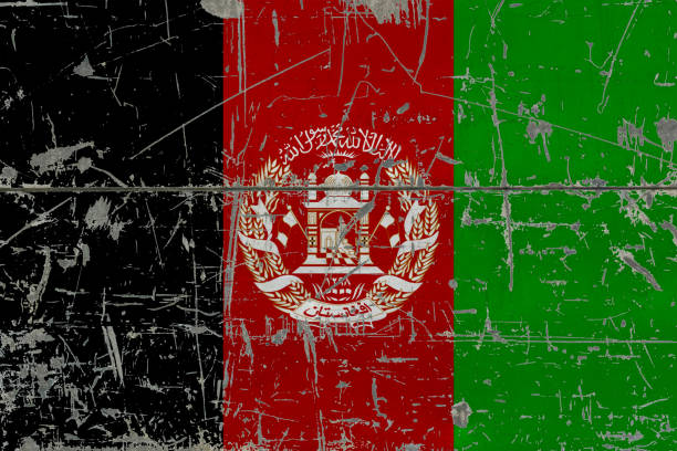 Grunge Afghanistan flag on old scratched wooden surface. National vintage background. stock photo