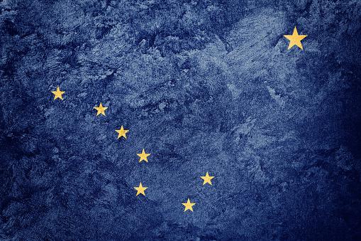 istock Grunge Alaska state flag. Alaska flag background grunge texture. 880801020