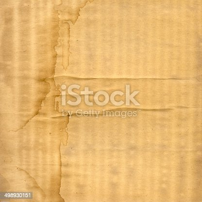 istock Grunge ancient used paper with dirty stains 498930151