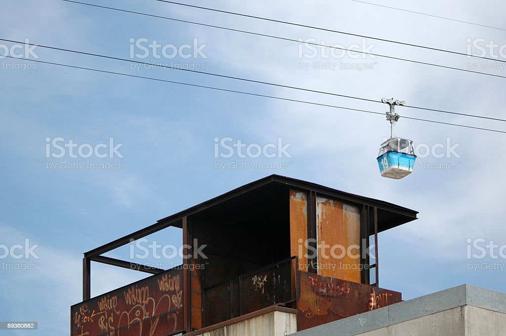 Grunge Architecture and Overhead Cable Car stock photo