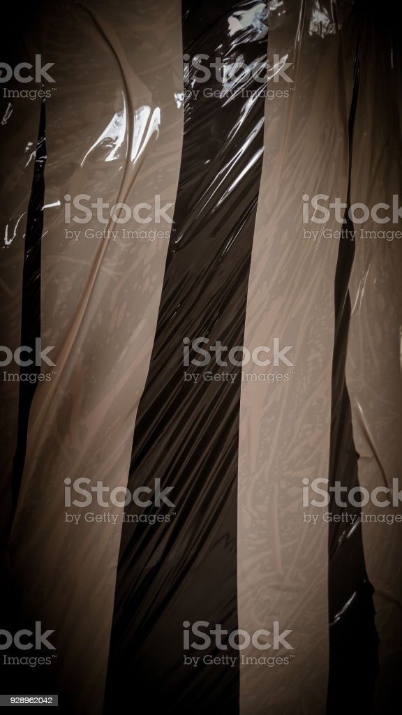 Grunge background of a duct tape on a package. Closeup of a brown scotch. stock photo