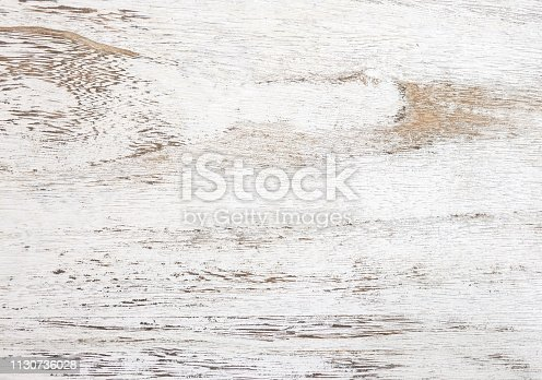 istock Grunge background. Peeling paint on an old wooden table. White wooden texture for background.  Top view. 1130736028