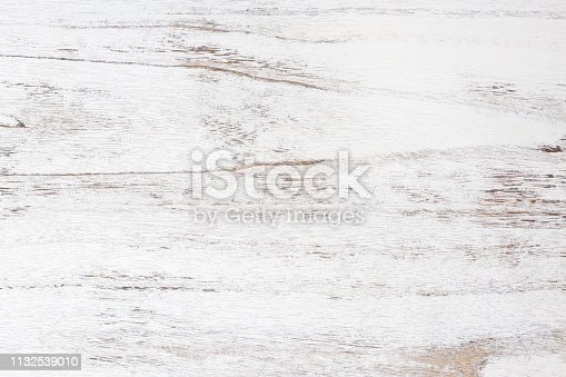 istock Grunge background. Peeling paint on an old wooden table. White wooden texture for background. 1132539010