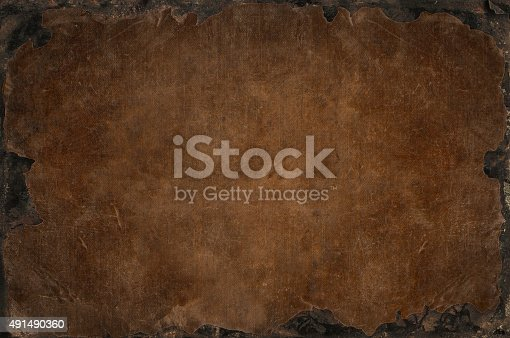 istock Grunge background with bleached distress texture with rusty iron frame 491490360
