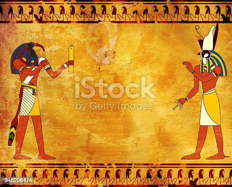 istock Grunge background with Egyptian gods images Toth and Horus 945208474