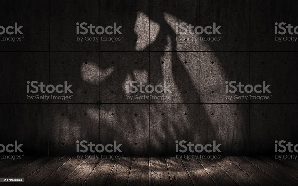 grunge background with shadow in the shape of a skull stock photo
