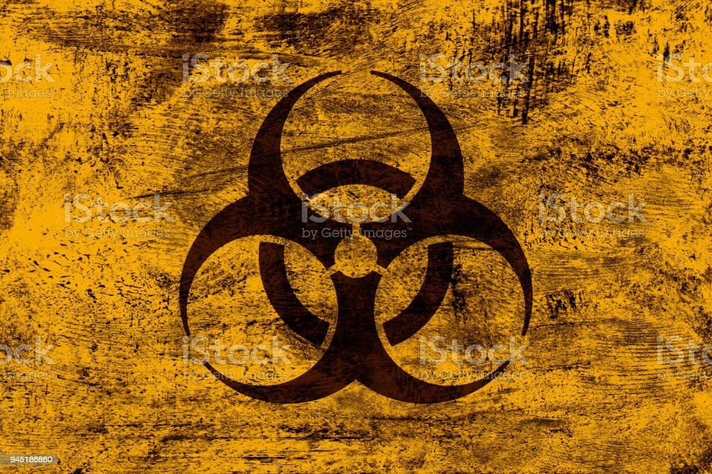 Grunge biohazard sign on yellow-orange grunge background stock photo