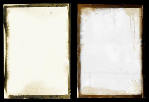 Set of two grunge black border instant print style frames on black