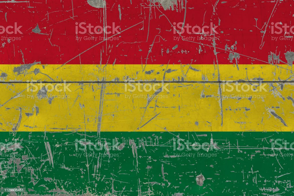 Grunge Bolivia flag on old scratched wooden surface. National vintage background. stock photo