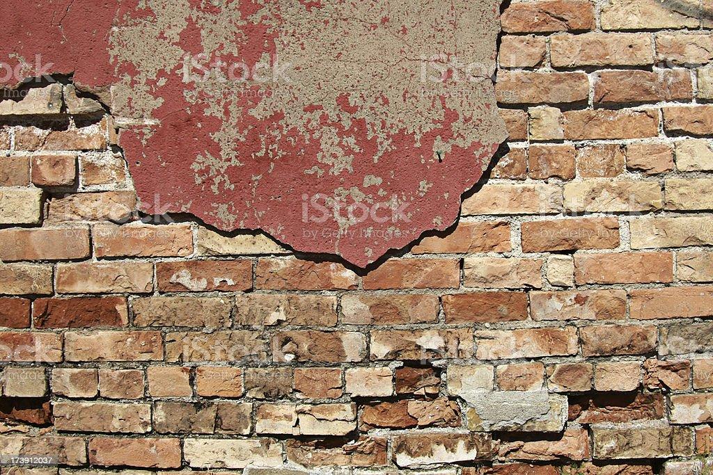 Grunge Brick under Decaying Red Plaster royalty-free stock photo