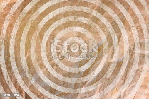 parchment Texture from an old wrinkled sheet of packing paper - Bullseye Target Concentric Circle Grunge background pattern based on a composite of several texture images and enhanced with computer designs  - a great graphic element and backdrop for a poster design with plenty of copyspace.