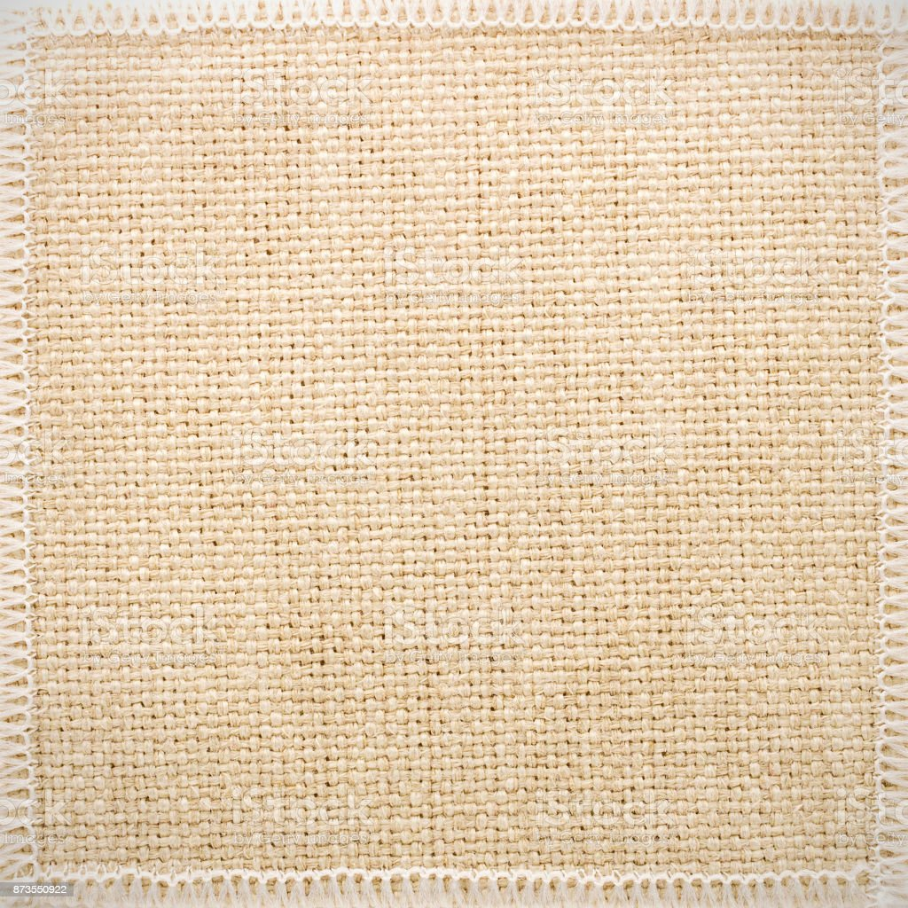 Grunge burlap texture background. Rough fabric material. Detail of cloth and seam frame. stock photo