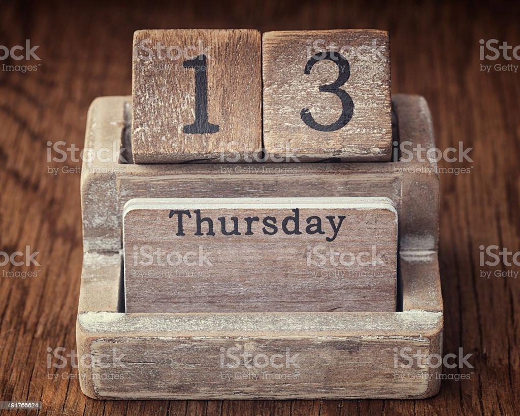Grunge calendar showing Thursday the thirteenth on wood backgrou stock photo