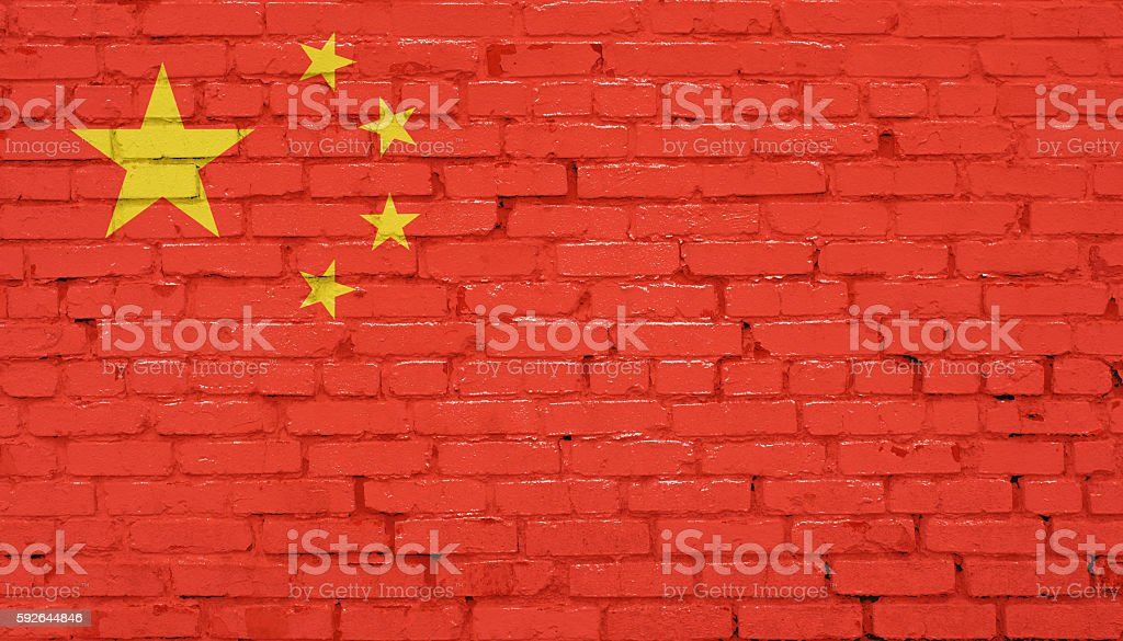 Grunge Chinese flag on wall stock photo