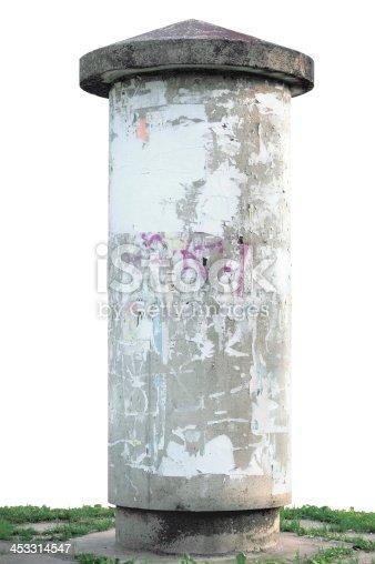 istock Grunge concrete advertising pillar, isolated weathered aged blank empty 453314547