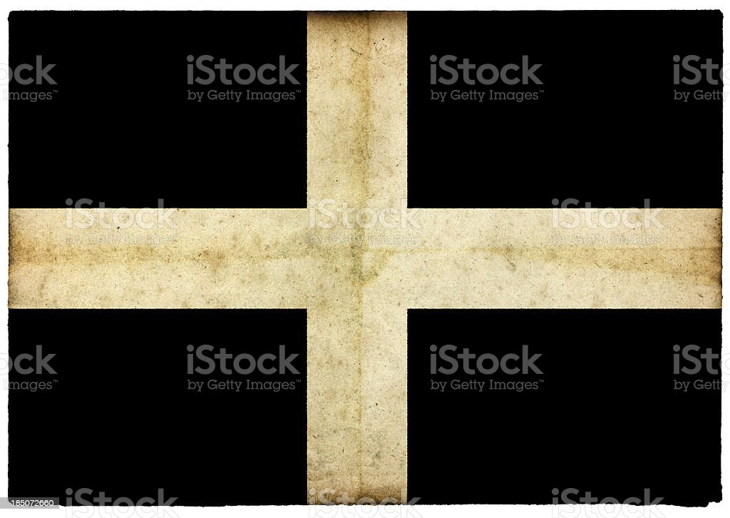 Grunge Cornwall Flag on rough edged old postcard stock photo
