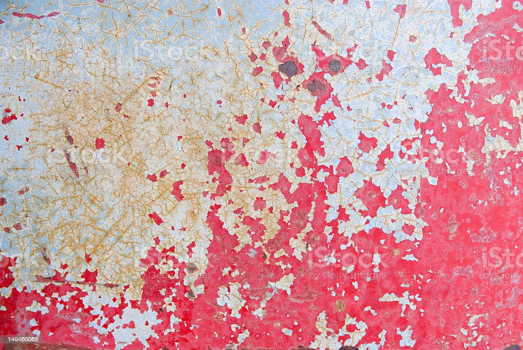 Grunge cracking peeling red paint on metal background royalty-free stock photo