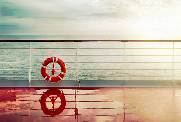 Grunge cruise deck background Grunge cruise deck background at dawn.Lifebuoy hand railing deck. Vintage look. buoy stock pictures, royalty-free photos & images