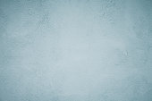 istock Grunge Decorative Faded Blue Plaster Background 697576416