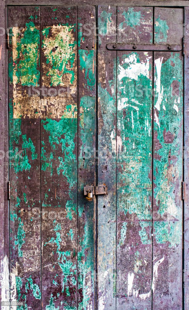 Grunge door with chipped paint and rough texture stock photo
