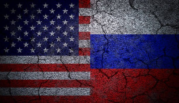Grunge Dual Flags of Russia and United States on Concrete stock photo