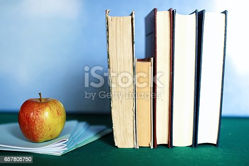 istock grunge effect photo education book stack apple pen 657805750