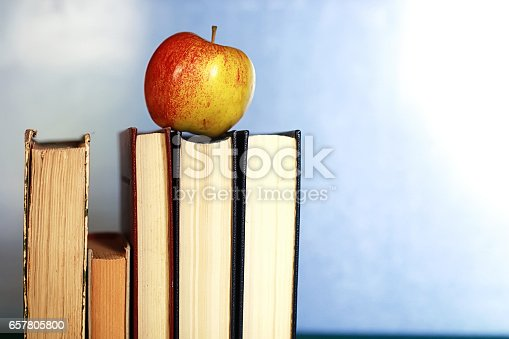 istock grunge effect photo education book stack apple pen 657805800