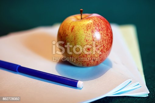 istock grunge effect photo education book stack apple pen 852728352