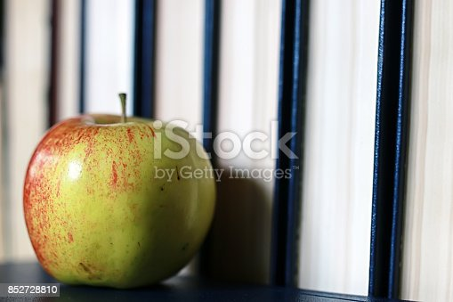 istock grunge effect photo education book stack apple pen 852728810