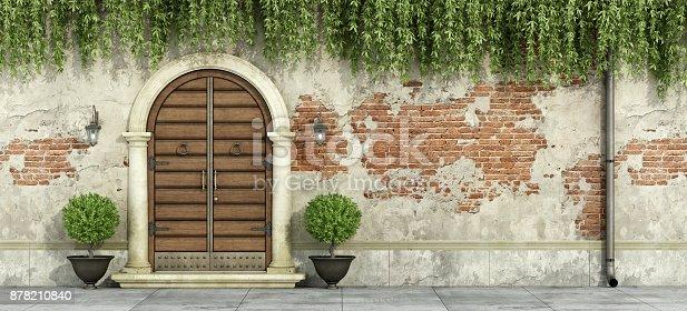 istock Grunge facade with wooden doorway 878210840