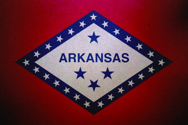 Grunge flag of Arkansas printed on a paper stock photo