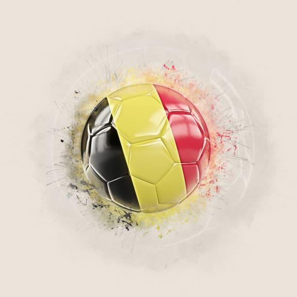 Grunge football with flag of belgium stock photo