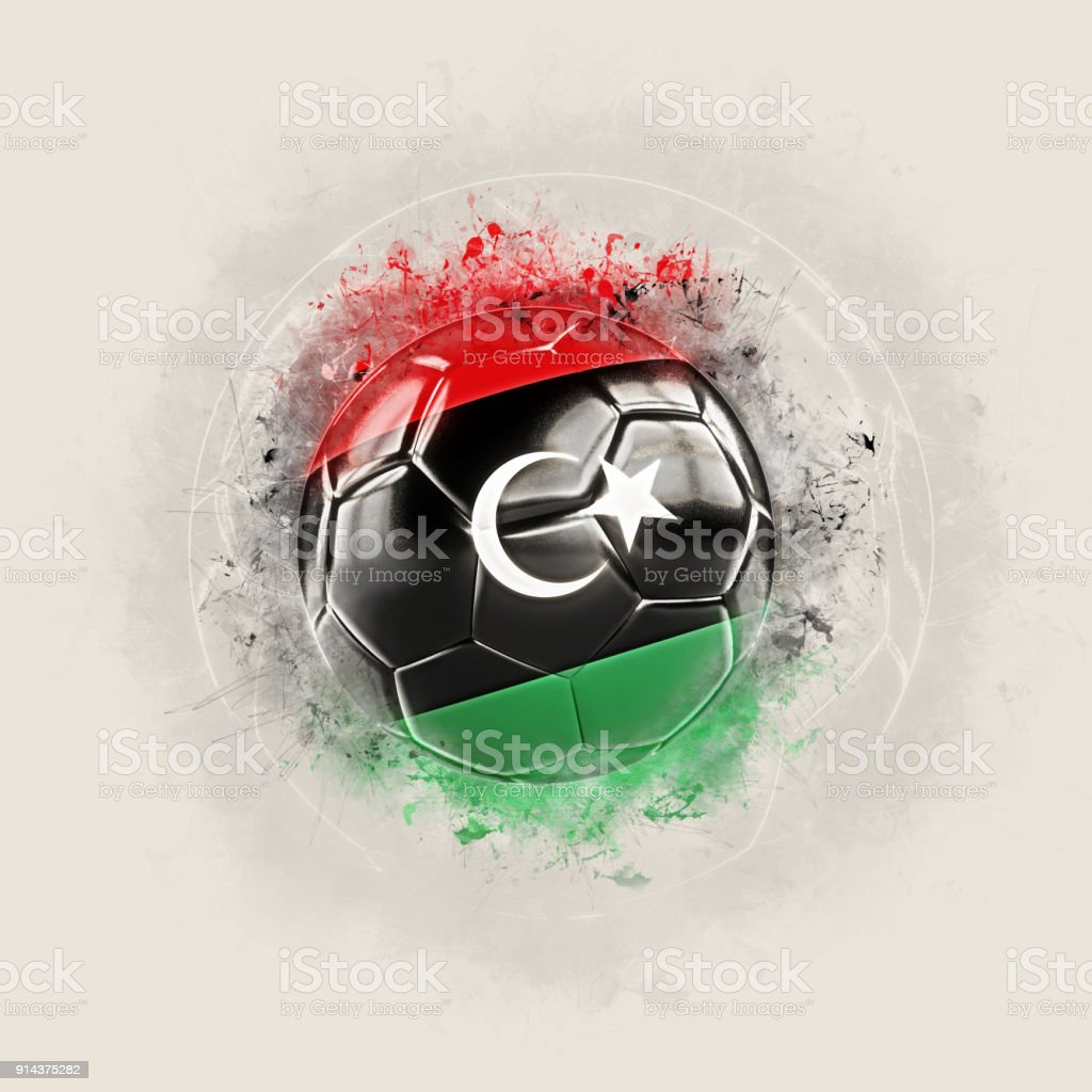Grunge football with flag of libya stock photo