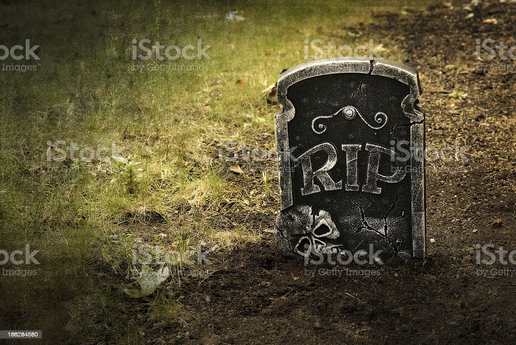 Grunge grave with tombstone stock photo