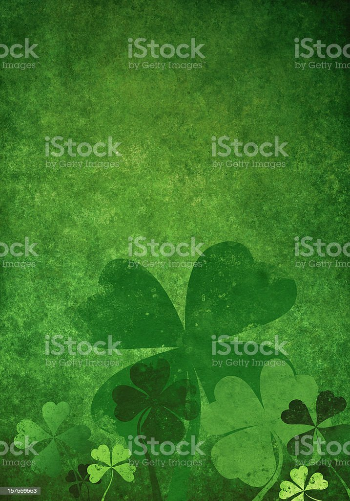 Grunge green background with four leaf clovers royalty-free stock photo