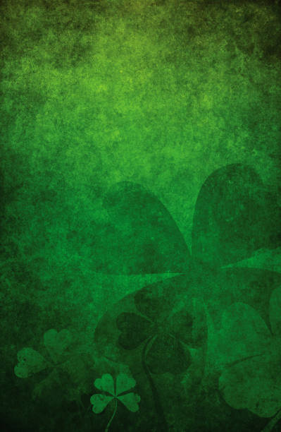 grunge green background with four leaf clovers - st patricks day background stock photos and pictures