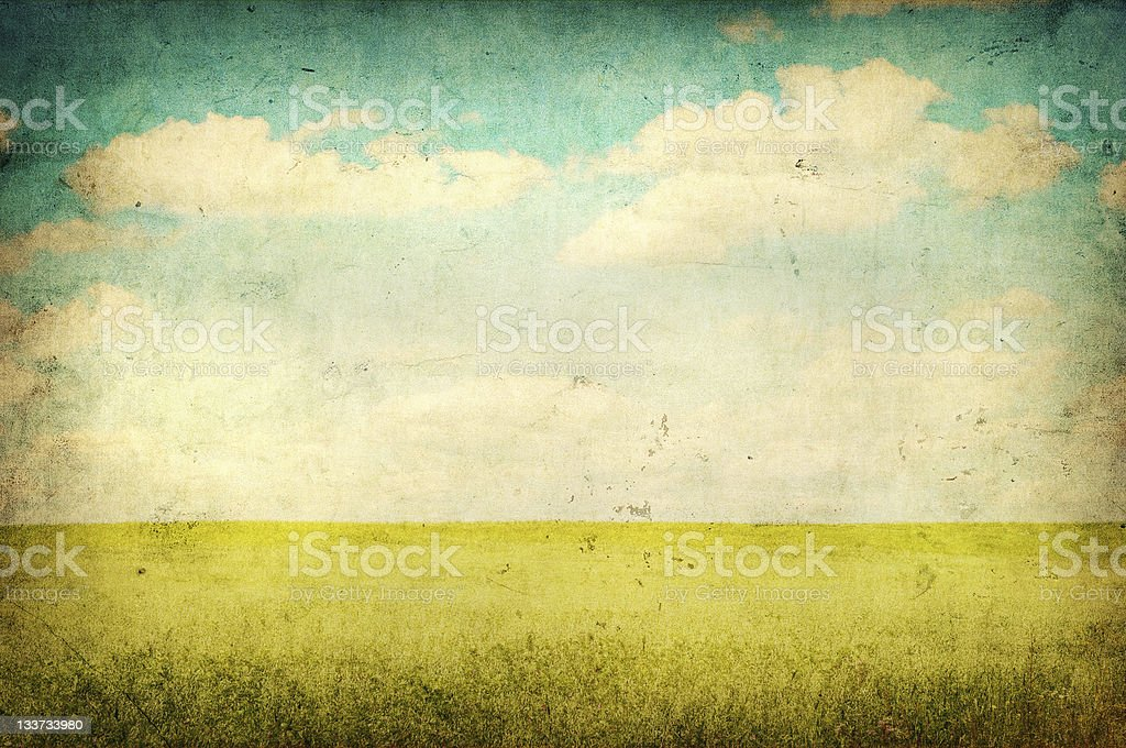grunge image of green field and blue sky stock photo