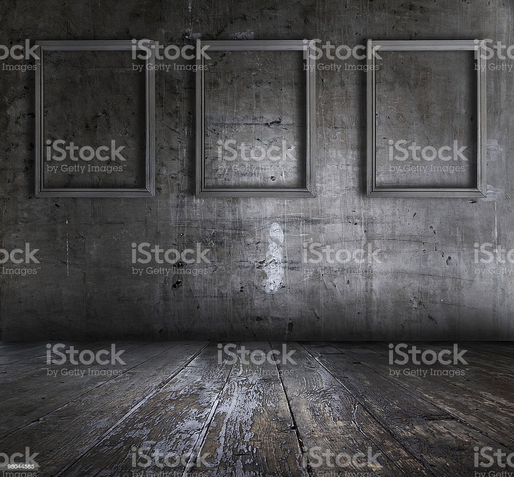 grunge interior with picture frames royalty-free stock photo