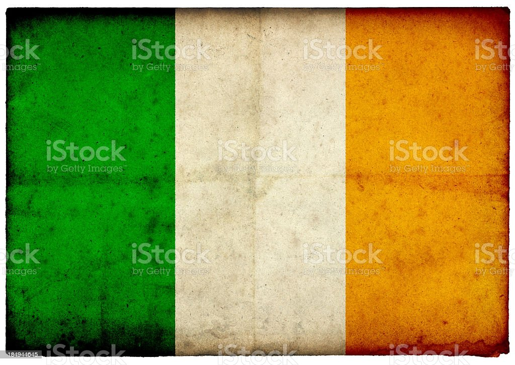 Grunge Irish Flag on rough edged old postcard stock photo