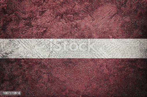 Grunge Latvia flag. Latvia flag with grunge texture.