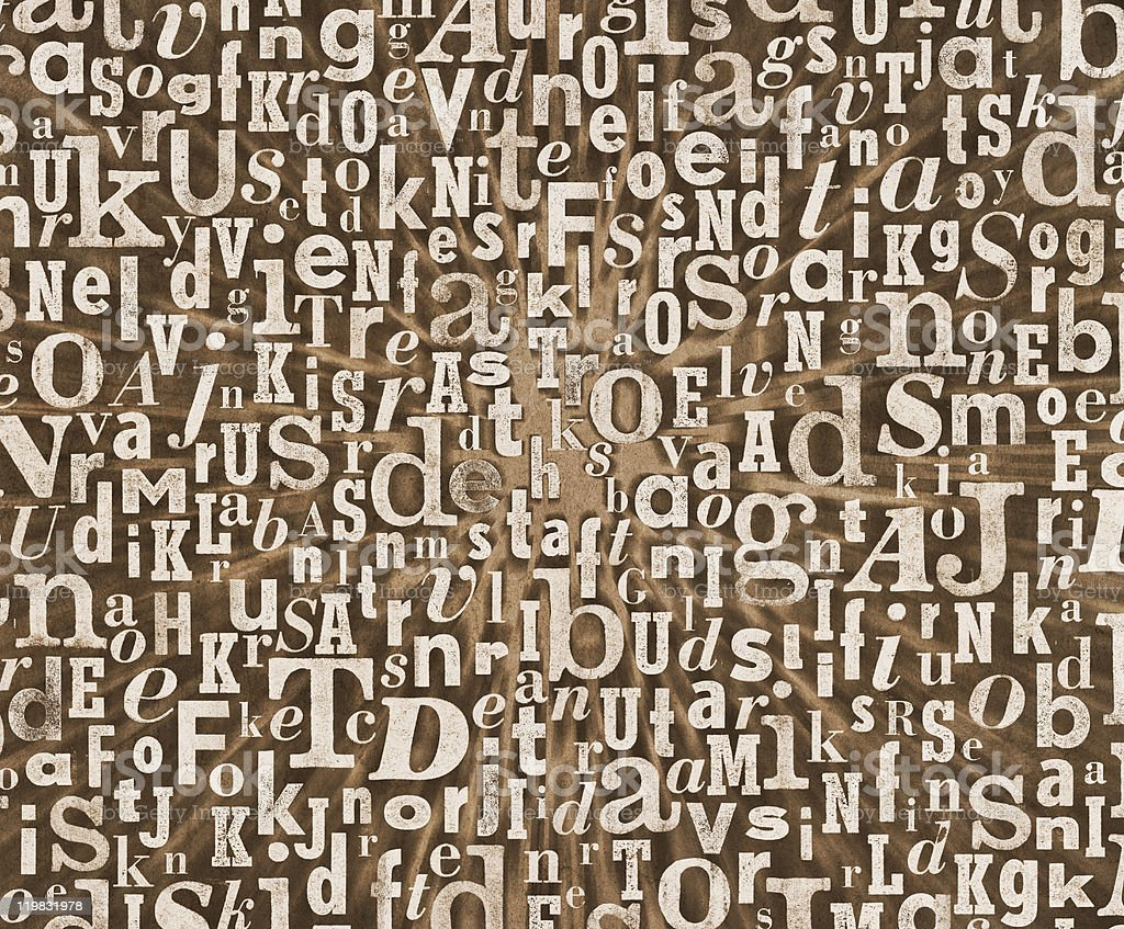 Grunge letter pattern on a brown background royalty-free stock photo