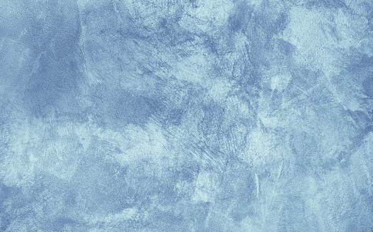 Abstract Grunge Decorative Light Blue Cyan Painted Stucco Wall Texture. Handmade Rough Winter Christmas Paper Background With Copy Space