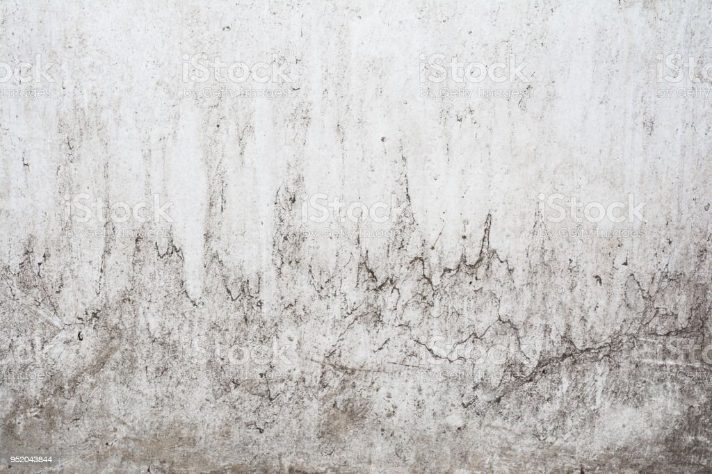 grunge light gray texture of an old wall with black divorces, white surface with smudges, abstract background stock photo