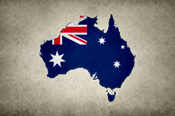 Grunge map of Australia with its flag printed within stock photo