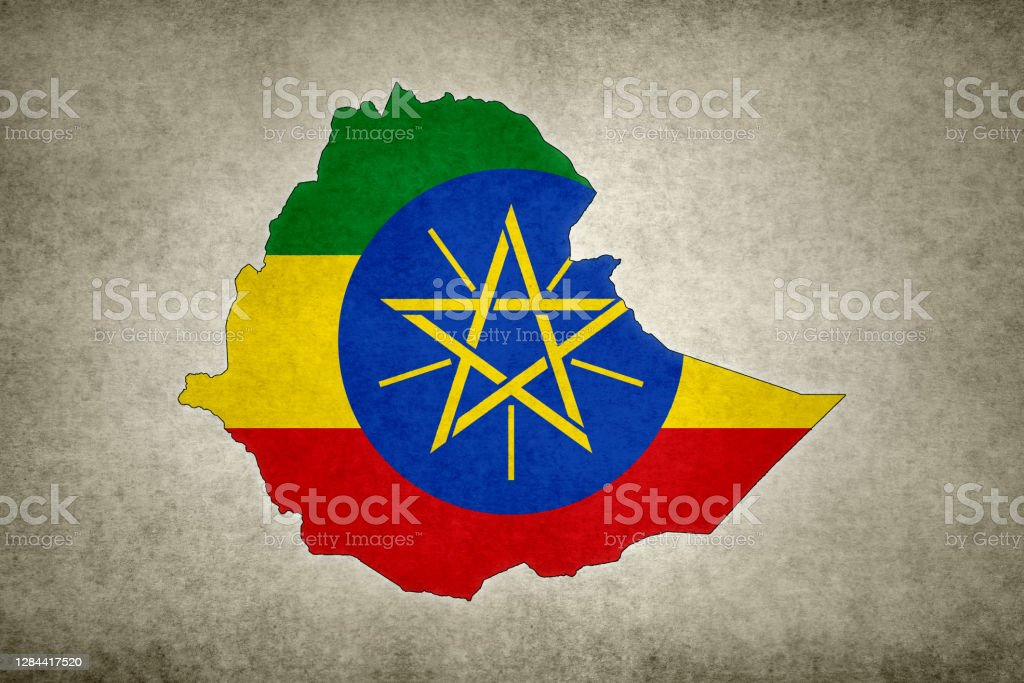 Grunge map of Ethiopia with its flag printed within Grunge map of Ethiopia with its flag printed within its border on an old paper. Abstract Stock Photo