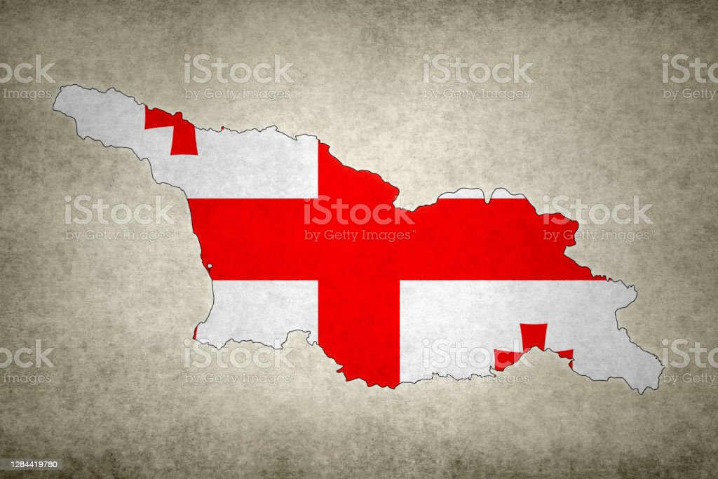 Grunge map of Georgia with its flag printed within Grunge map of Georgia with its flag printed within its border on an old paper. Abstract Stock Photo