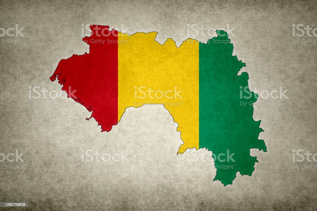 Grunge map of Guinea with its flag printed within Grunge map of Guinea with its flag printed within its border on an old paper. Abstract Stock Photo