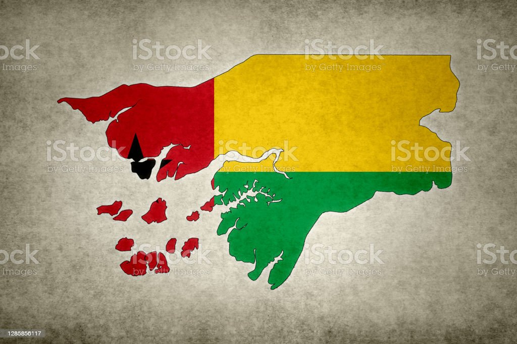 Grunge map of Guinea-Bissau with its flag printed within Grunge map of Guinea-Bissau with its flag printed within its border on an old paper. Abstract Stock Photo