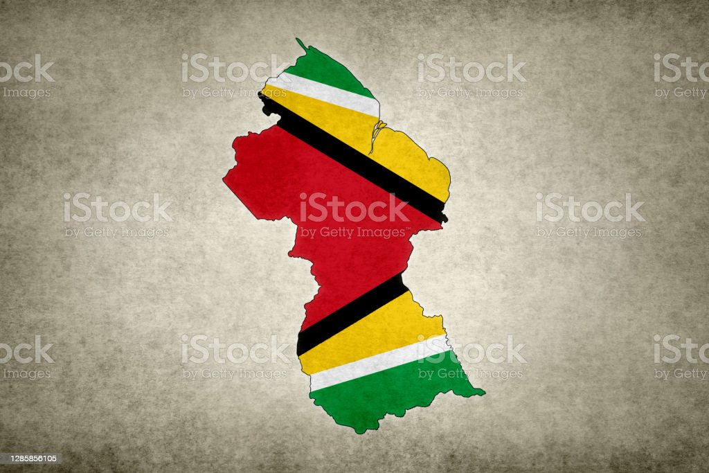 Grunge map of Guyana with its flag printed within Grunge map of Guyana with its flag printed within its border on an old paper. Abstract Stock Photo